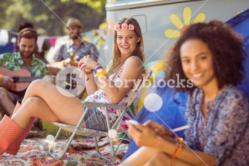 Carefree hipster relaxing on campsite