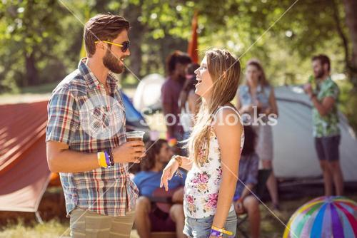 Hipster friends chatting on campsite