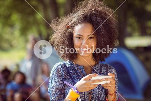 Pretty hipster sending text message