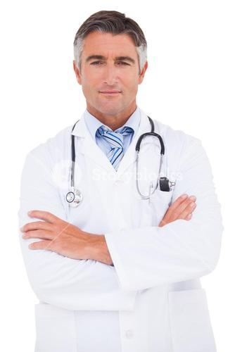 Serious doctor looking at camera