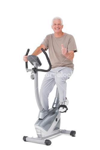 Senior man on exercise bike