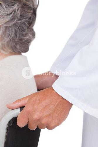 Doctor pushing patient in wheelchair