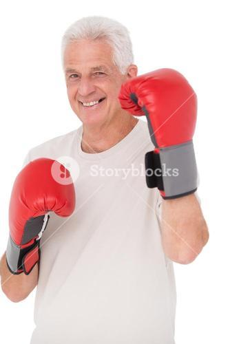 Senior man in boxing gloves