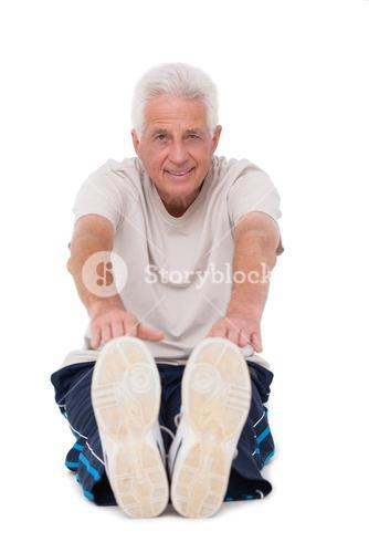 Senior man touching his toes