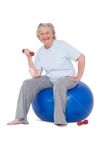 Senior woman sitting on exercise ball