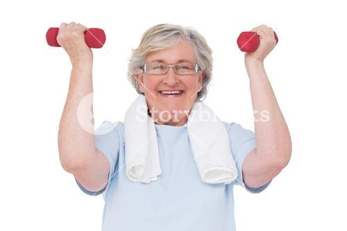 Senior woman lifting hand weights