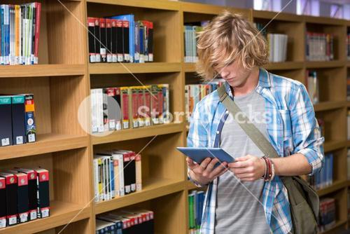 Student using tablet in library