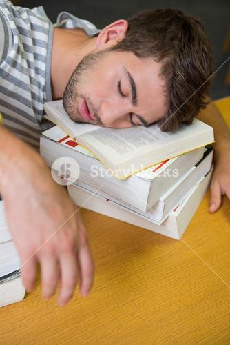 Student asleep in the library