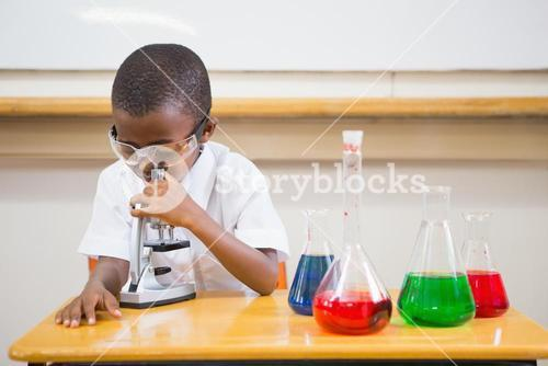 Pupil looking through microscope