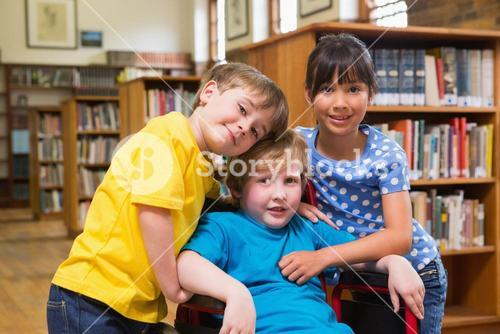Cute pupils hugging at the library
