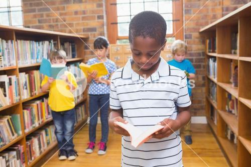 Pupils looking for books in library