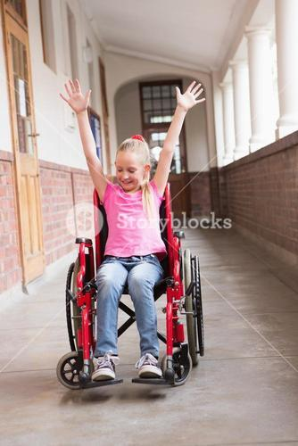 Cute disabled pupil smiling in hall