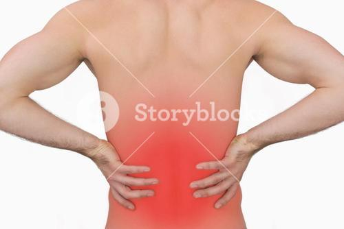 Rear view of muscular man with backache