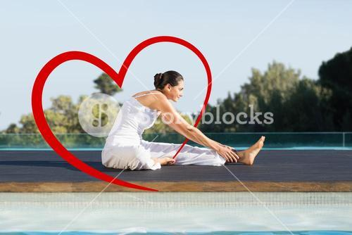 Composite image of peaceful brunette in janu sirsasana yoga pose poolside