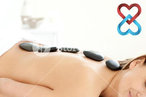 Composite image of attractive woman receiving a spa treatment