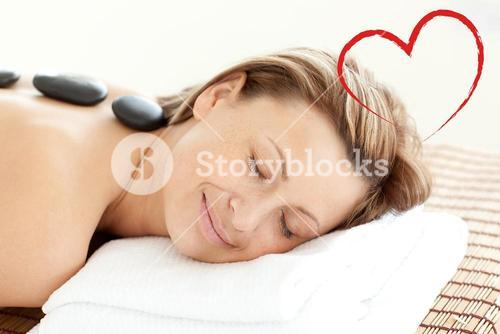 Composite image of beautiful woman receiving a spa treatment