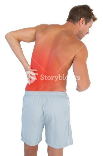 Man with shorts suffering from lower back pain