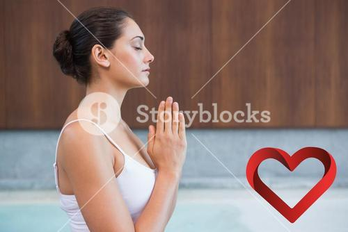 Composite image of content brunette in white sitting in lotus pose