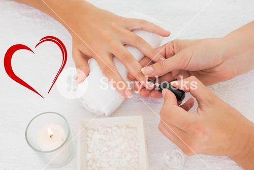 Composite image of nail technician painting customers nails