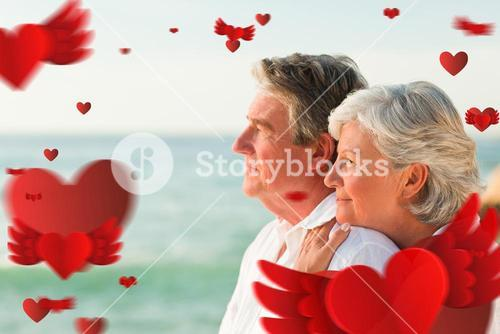 Composite image of woman hugging her husband at the beach