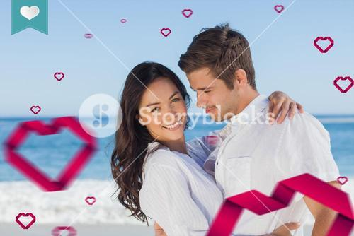Composite image of young couple embracing and posing on the beach
