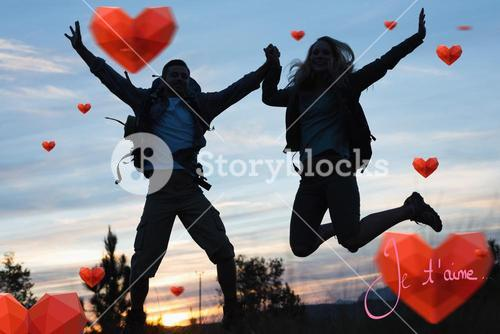 Composite image of silhouette couple jumping against the sky