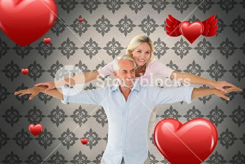 Composite image of smiling couple posing with arms out