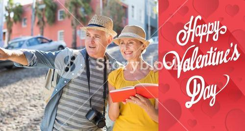 Composite image of happy tourist couple using guide book in the city
