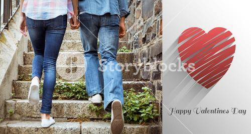 Composite image of hip young couple walking up steps