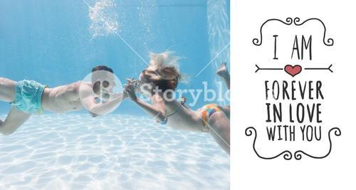 Composite image of cute couple kissing underwater in the swimming pool
