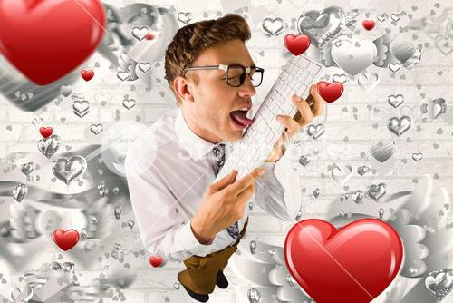 Composite image of geeky businessman licking his keyboard