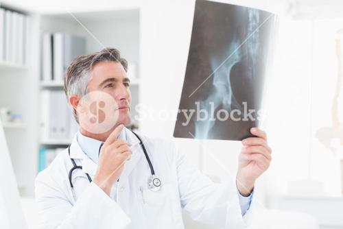 Doctor analyzing x-ray in clinic