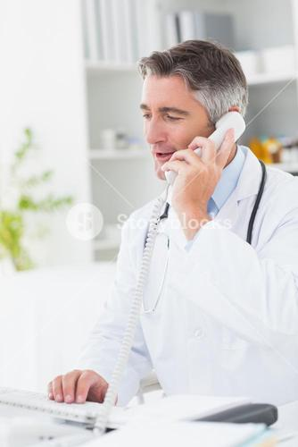 Doctor using computer while on call