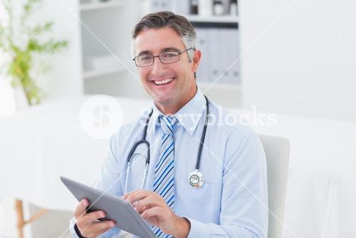 Portrait of doctor using tablet computer