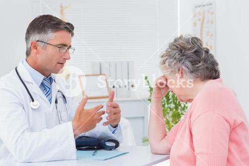 Doctor talking to tensed patient