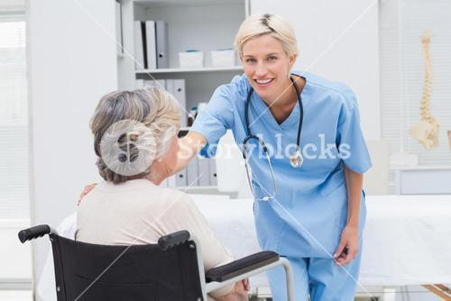 Portrait of nurse consoling patient sitting on wheelchair
