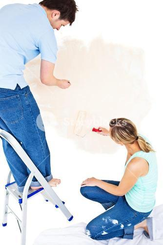 Concentrated couple painting a room