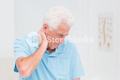 Senior man suffering from neck ache