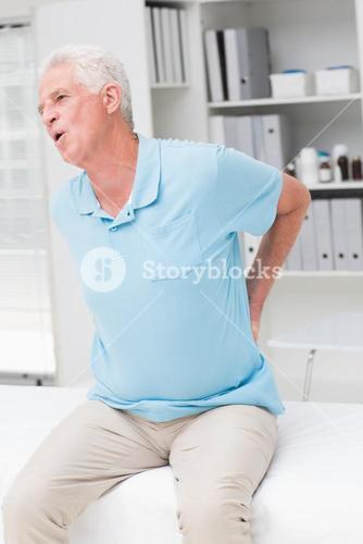 Senior man screaming due to back pain