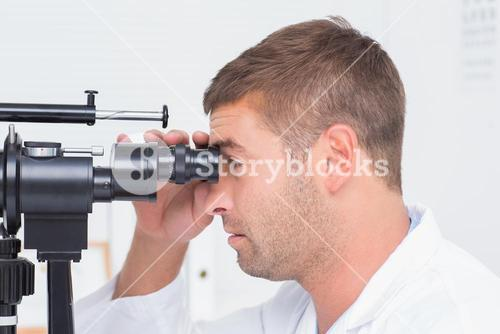 Optician using slit lamp in clinic
