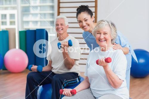 Portrait of happy instructor with senior couple