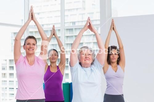 Friend with hands clasped exercising in gym