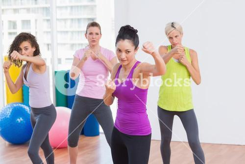 Women boxing at fitness studio