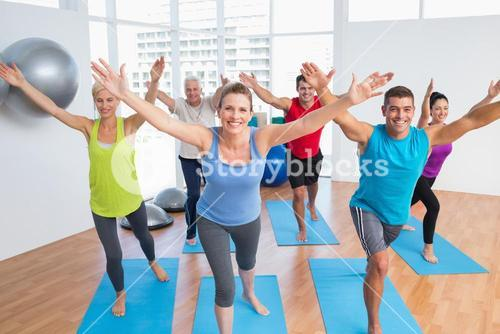 People exercising in gym class