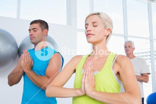 People meditating in gym class