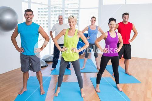 Happy people exercising in gym class