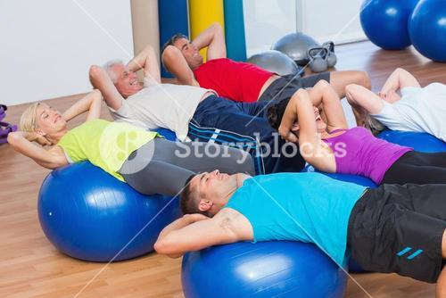 People stretching on exercise balls