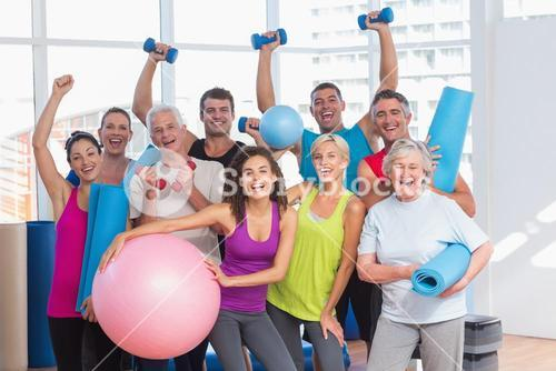 Excited people holding exercise equipment