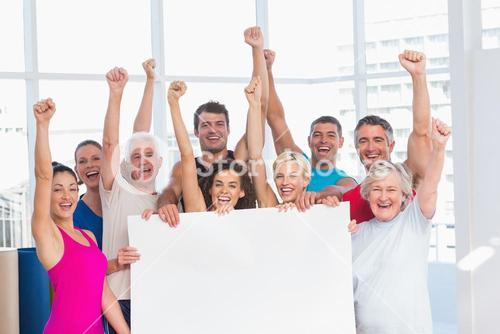 Excited people holding blank billboard