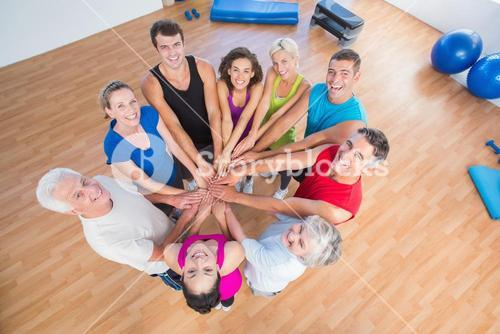 Portrait of fit people stacking hands